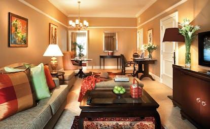 Ritz Carlton Kuala Lumpur premier suite lounge tables armchairs modern décor
