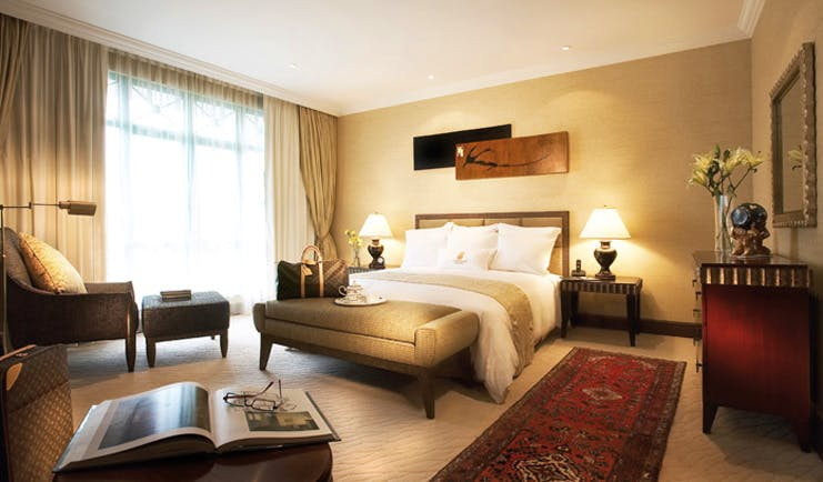 Ritz Carlton Kuala Lumpur suite bedroom bed armchair modern décor