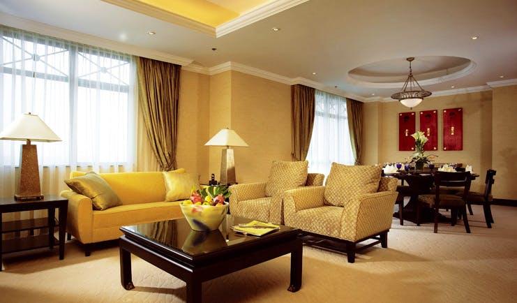 Ritz Carlton Kuala Lumpur suite lounge sofas armchairs modern décor