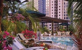 Four Seasons Singapore outdoor pool flowers loungers palms umbrellas