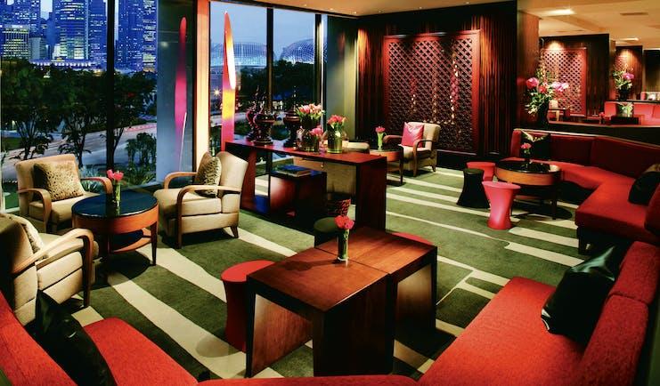 Mandarin Oriental Singapore lounge indoor communal seating area bright modern décor