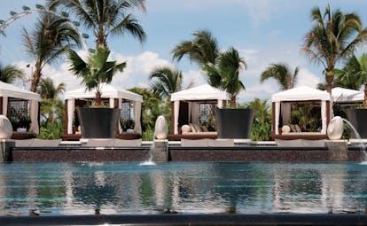 Mandarin Oriental Singapore pool sun beds cabanas palm trees