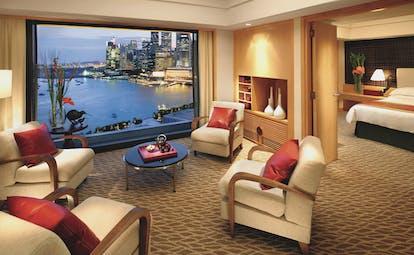 Mandarin Oriental Singapore suite lounge indoor seating area bed window overlooking harbour