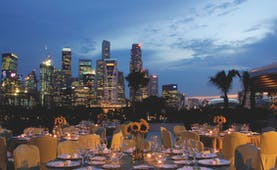 Mandarin Oriental Singapore terrace outdoor dining overlooking harbour city in background
