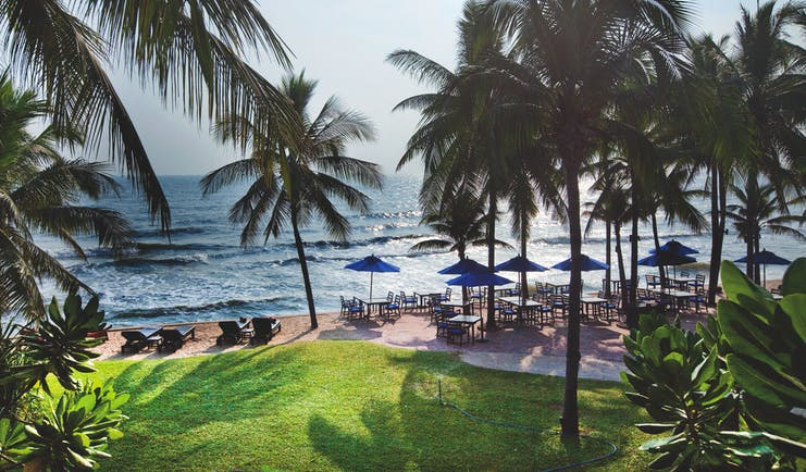 Anantara Hua Hin Thailand beach sun loungers umbrellas outdoor seating palm trees