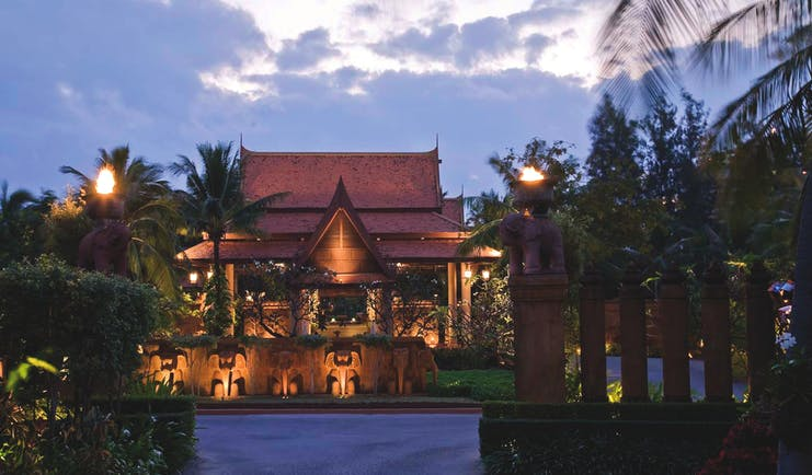Anantara Hua Hin Thailand entrance at night traditional architecture lawns trees