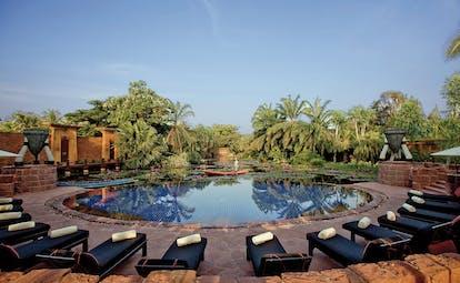 Anantara Hua Hin Thailand pool sun loungers overlooking lagoon trees