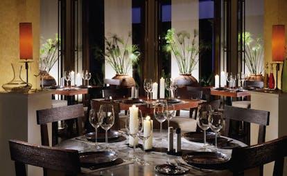 Anantara Siam Bangkok Thailand dining minimalist decor white candles urns with bamboo