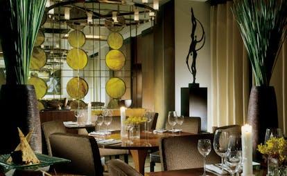 Anantara Siam Bangkok Thailand indoor dining modern decor artwork candle chandelier