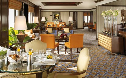 Anantara Siam Bangkok Thailand lounge breakfast large room with dining area and seating area with sofa