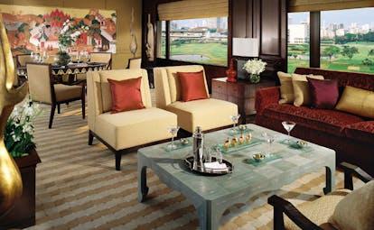 Anantara Siam Bangkok Thailand lounge traditional Asian artwork large windows garden and city views