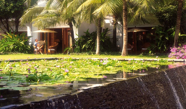 Anantara Siam Bangkok Thailand ponds with water lilies gardens and palm trees