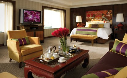 Anantara Siam Bangkok Thailand suite bedroom sitting area with sofa and tea tray