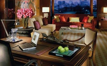 Anantara Siam Bangkok Thailand suite living room writing desk sofa large window city view