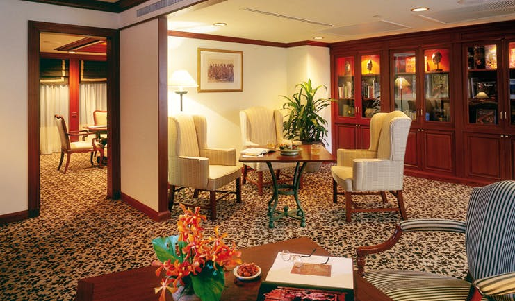 Anantara Siam Bangkok Thailand suite lounge classic decor seating area cabinets with antiques