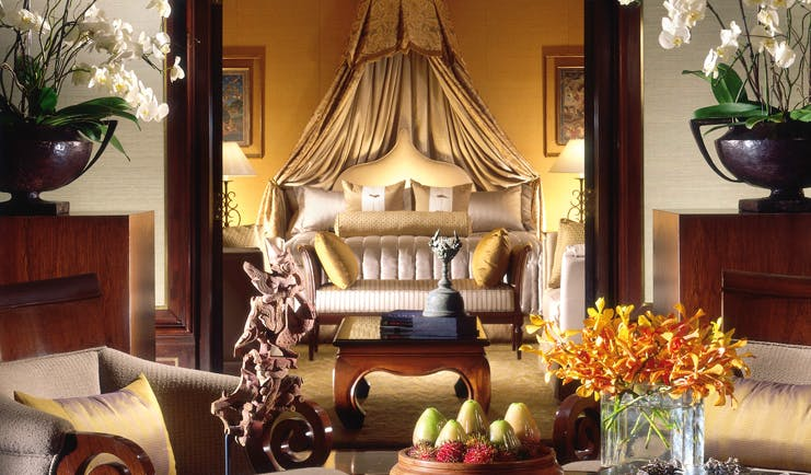 Anantara Siam Bangkok Thailand suite double bed with drapes sitting area opulent decor