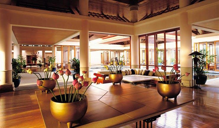 Banyan Tree Phuket Thailand lobby lounge area sofa flowers modern style