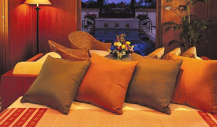 Banyan Tree Phuket Thailand pool villa seating area sofa chairs view to pool