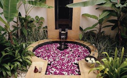Banyan Tree Phuket Thailand sunken bath tub pink floating flowers