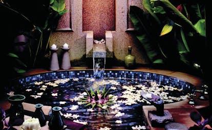 Banyan Tree Phuket Thailand sunken bathtub waterfall tap floating flowers