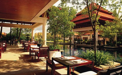 Banyan Tree Phuket Thailand Tamarind spa covered outdoor dining area pond pavilion view