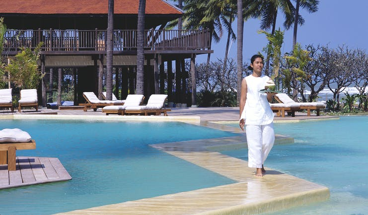 Evason Hua Hin Resort Thailand outdoor pool building with balcony overlooking outdoor pool loungers palm trees