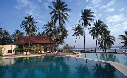 Evason Hua Hin Resort Thailand outdoor swimming pool loungers palm trees ocean view