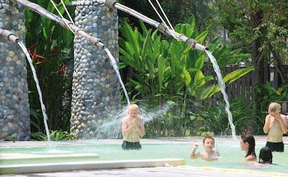 Evason Hua Hin Resort Thailand pool waterfall kids playing in a waterfall pool