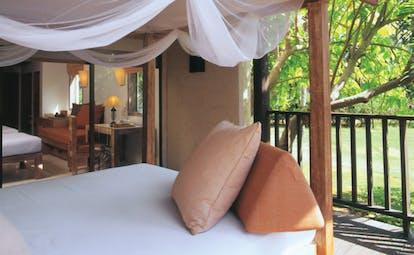 Evason Hua Hin Resort Thailand studio room balcony bed trees sofas