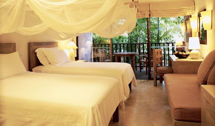 Evason Hua Hin Resort Thailand twin bedroom mosquito drapes sofa balcony