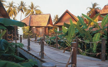 Evason Hua Hin Resort Thailand villa walkway decked path and greenery to villas