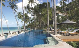 Four Seasons Koh Samui Thailand pool sun loungers umbrellas pool on beach front