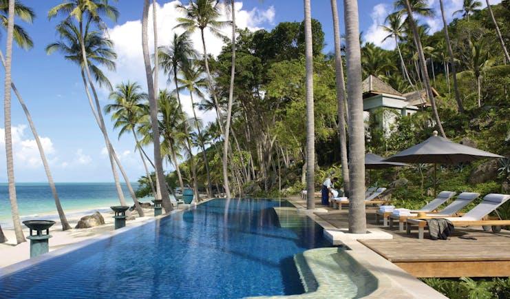 Four Seasons Koh Samui Thailand pool sun loungers umbrellas pool on beach front
