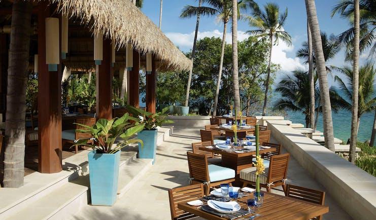 Four Seasons Koh Samui Thailand terrace outdoor dining area overlooking sea