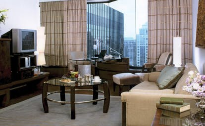 Grand Hyatt Erawan Bangkok Thailand grand suite lounge sofa desk panoramic city view