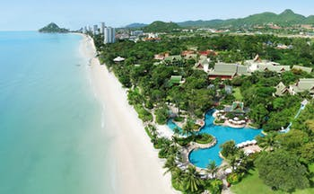 Hyatt Regency Hua Hin Thailand aerial view of resort beach ocean palm forest swimming pool