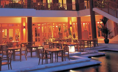 Hyatt Regency Hua Hin Thailand Figs restaurant indoor and outdoor dining area at night time