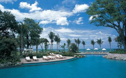 Hyatt Regency Hua Hin Thailand lagoon pool loungers palm trees ocean view