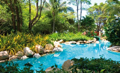 Hyatt Regency Hua Hin Thailand river pool gardens palm trees and bridge