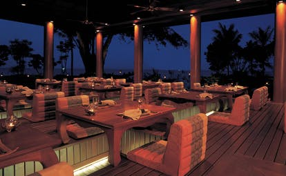 Hyatt Regency Hua Hin Thailand Talay Thai restaurant covered dining area comfy seating night time