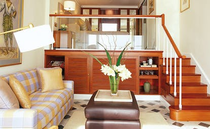 Mandarin Oriental Bangkok Thailand premier room mezzanine sitting area with steps to bed