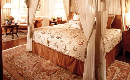 Mandarin Oriental Bangkok Thailand royal oriental bedroom four poster bed traditional decor
