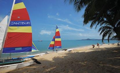 Santiburi Resort Thailand beach sailing boats moored on beach sand sea