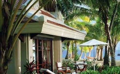Santiburi Resort Thailand beach front villa exterior gardens palm trees beach