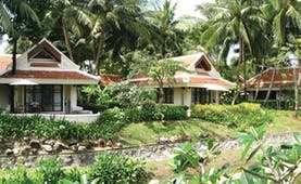 Santiburi Resort Thailand villa exteriors gardens lawns trees