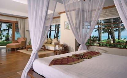 Santiburi Resort Thailand villa interior canopied bed lounge area modern décor