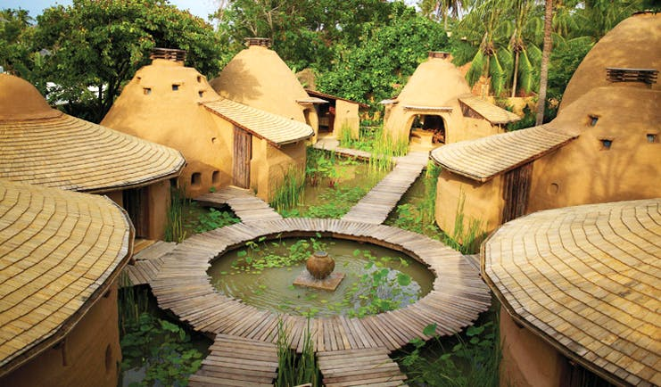 Six Senses Hua Hin Thailand Earthspa complex of traditional mud huts surrounding a lily pond