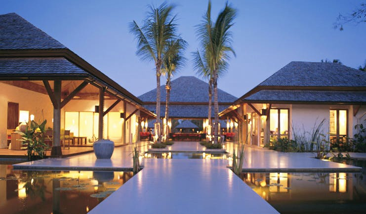 Six Senses Hua Hin Thailand reception exterior lily ponds white buildings
