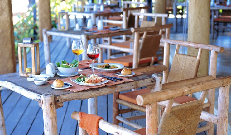 Six Senses Hua Hin Thailand The Beach restaurant wooden chairs tables deck area cuisine rustic
