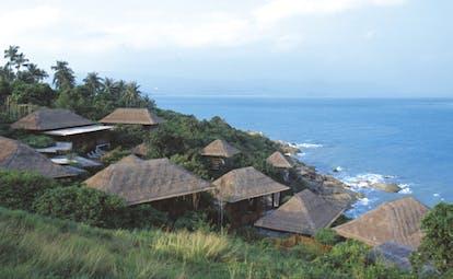 Six Senses Samui Thailand bungalow views thatched rooves palm forests ocean views